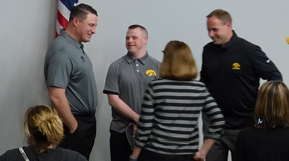 coaches talking with people