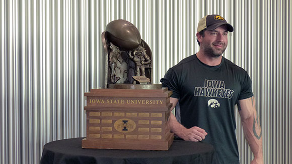 young man with cy-hawk trophy